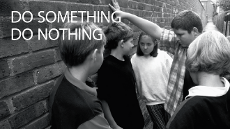 Text: do something | do nothing photo of kid getting bullied