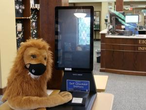 masked stuffed lion at self checkout