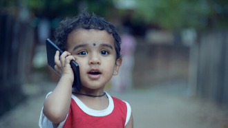 toddler answering cell phone