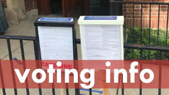 Text: voting info photo: two form boxes posted outside the library