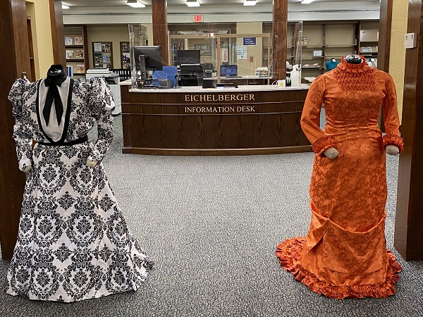 Dresses on exhibit at Wright Library